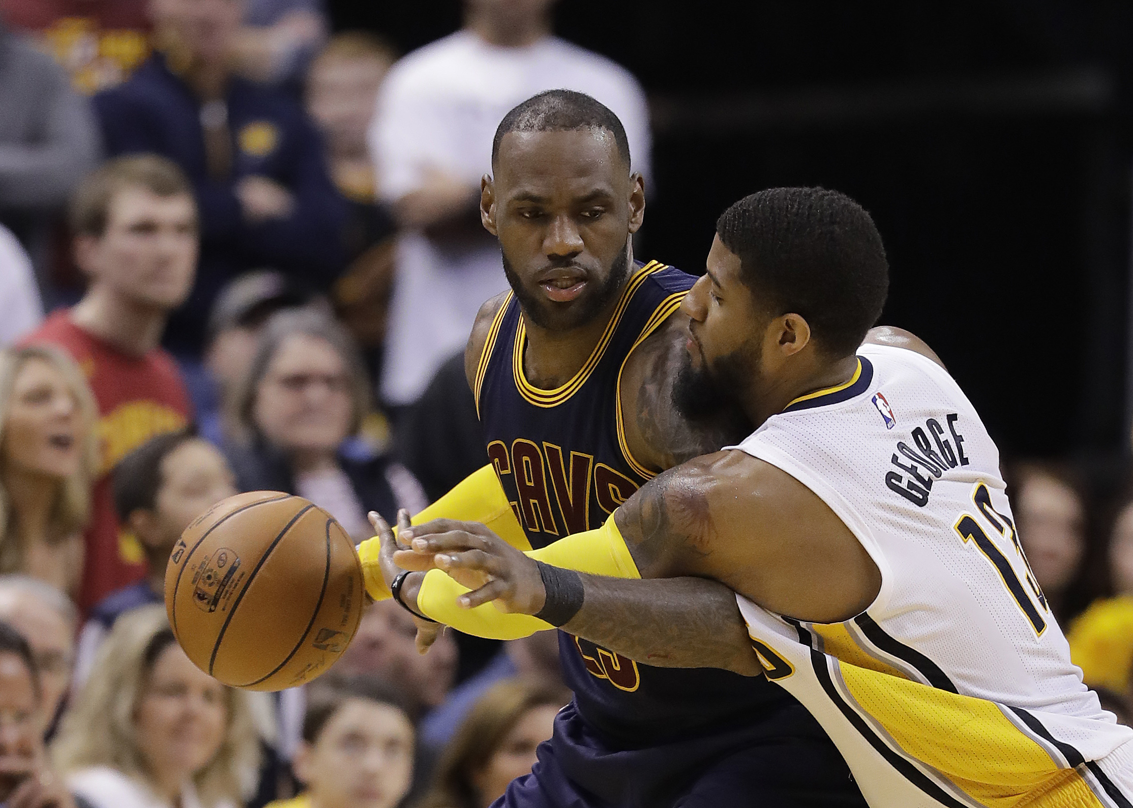 Cleveland Cavaliers' LeBron James is defended by Indiana Pacers' Paul George during the second half in Game 4 of their first-round NBA basketball playoff series, Sunday, April 23, in Indianapolis. (AP Photo/Darron Cummings)