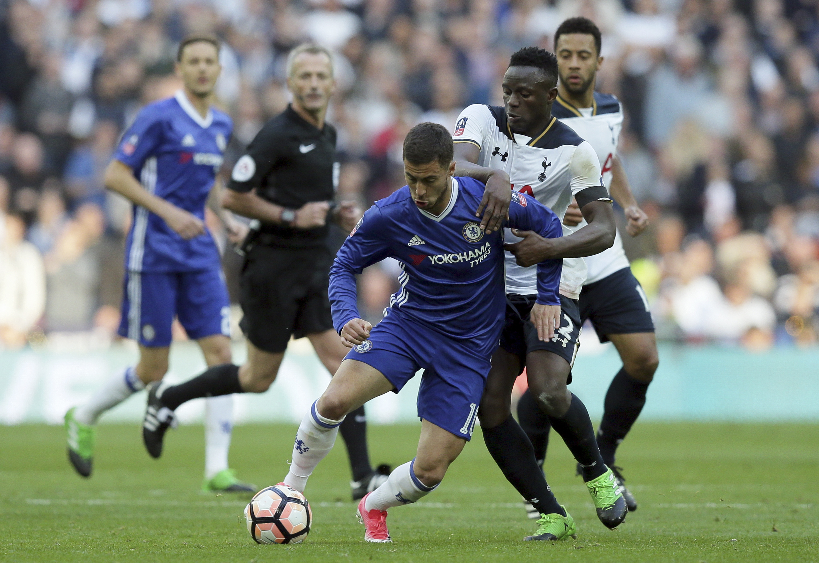 Chelsea's Eden Hazard vies for the ball with Tottenham's Victor Wanyama, center right, during their English FA Cup semifinal match at Wembley stadium in London, Saturday, April 22. (AP Photo/Tim Ireland)
