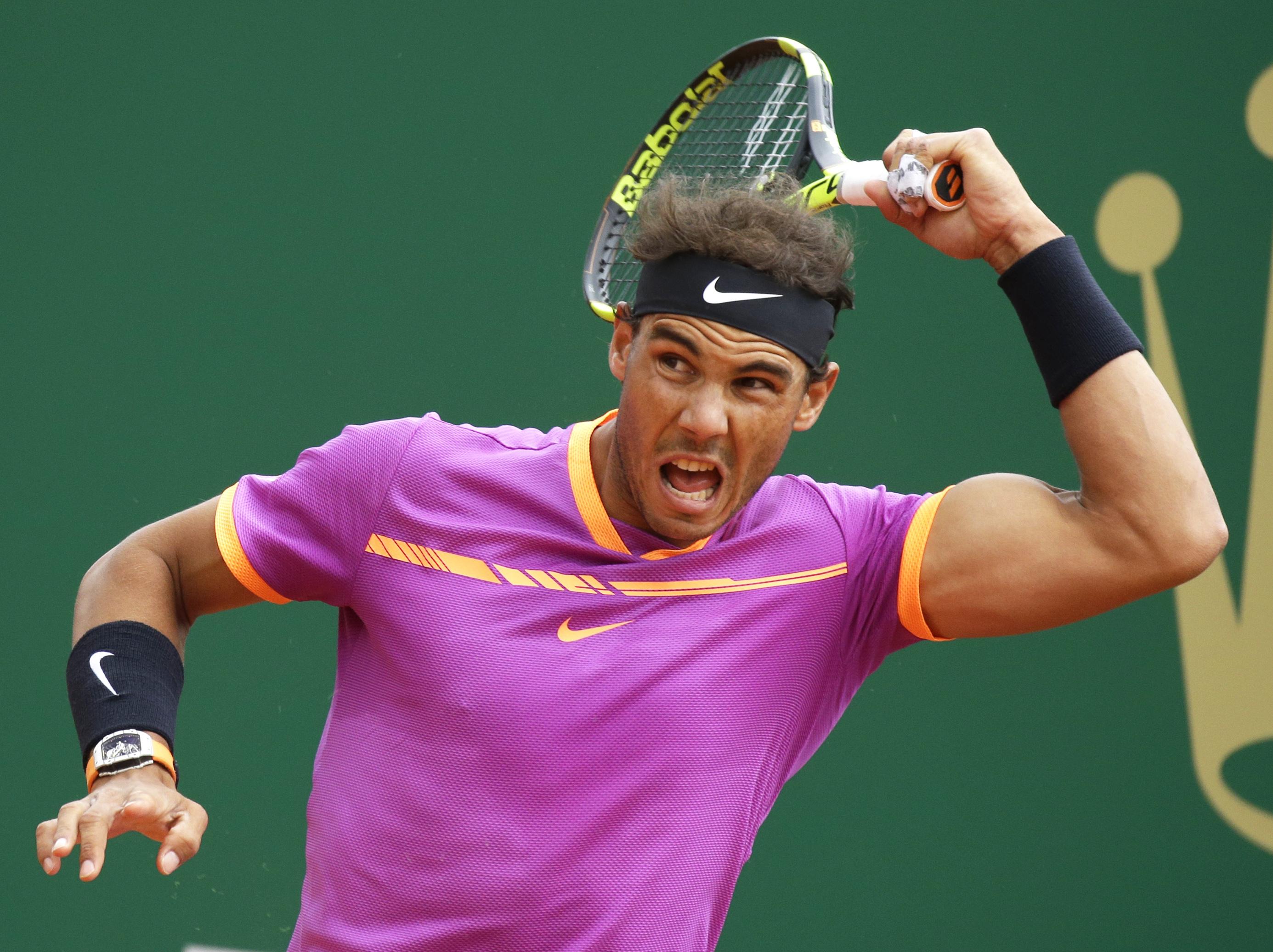 Spain's Rafael Nadal returns the ball to Spain's Albert Ramos-Vinolas during the men's final at the Monte Carlo Tennis Masters tournament in Monaco, Sunday, April, 23. (AP Photo/Claude Paris)