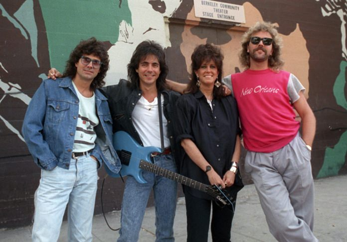 In this July 24, 1987 file photo, members of Starship, from left, Mickey Thomas, Craig Chaquico, Grace Slick and Donny Baldwin, pose outside the Berkeley Community Theater in Berkeley, Calif. (AP Photo/Doug Atkins)