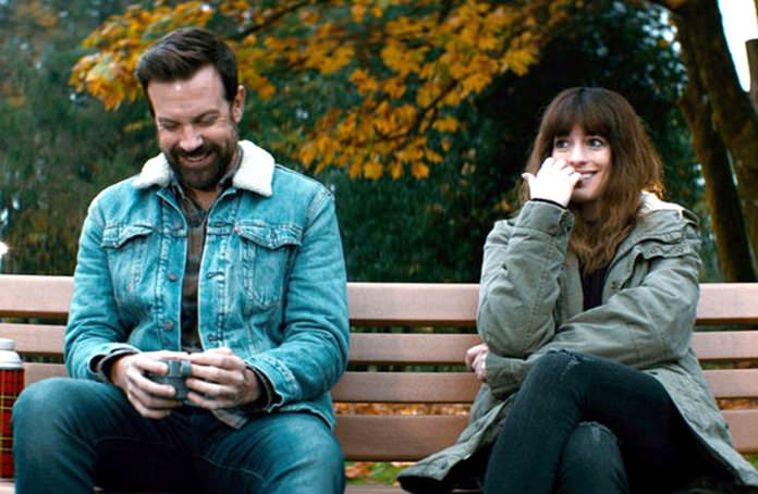 "Jason Sudeikis (left) and Anne Hathaway are shown in a scene from ""Colossal."" (Neon via AP)"