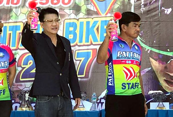 Teerasak Jatupong, director of Pattaya's defense and security department, and Manoj Nongyai, president of the Pattaya Bicycle Association, set the competitiors on their way at the Pattaya Mountain Bike Challenge event, Sunday, April 30.