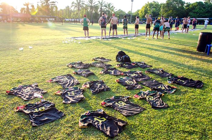 Shirts discarded, a team cools down on the touchline after a long, hot day.