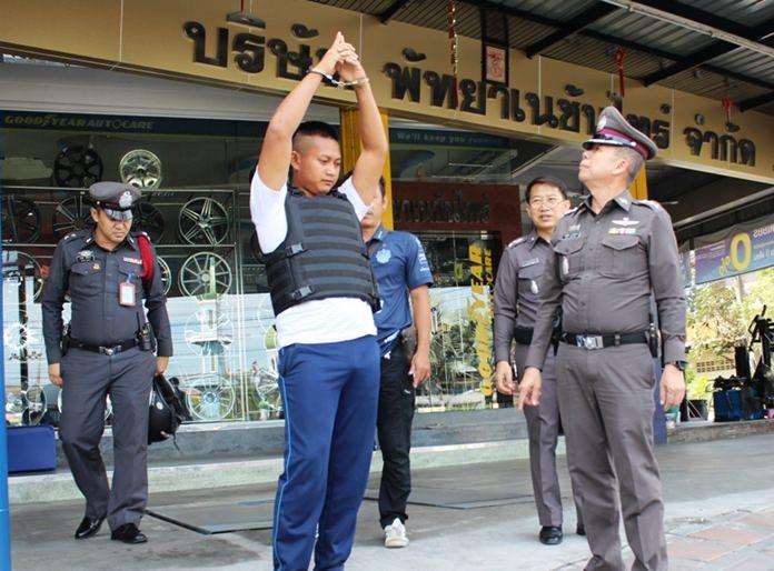 Kamol Tukcharoen was taken for a crime re-enactment outside Naklua's Yanyon shop on Sukhumvit Road.