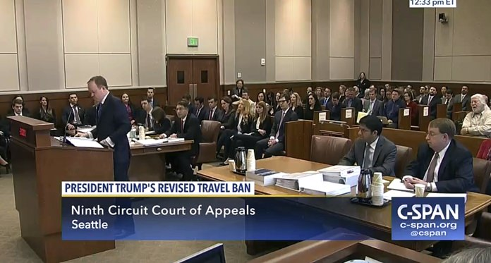 In this image made from a C-SPAN video, Acting Solicitor General Jeffrey Wall, standing at left, presents his arguments during a 9th Circuit Court of Appeals panel in Seattle, Monday, May 15, 2017. (CSPAN via AP, Pool)