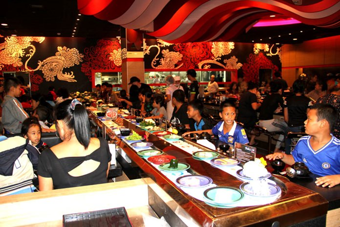 The restaurant was a do it yourself buffet affair where you chose what you want from a moving runway that went in and out of all the tables.