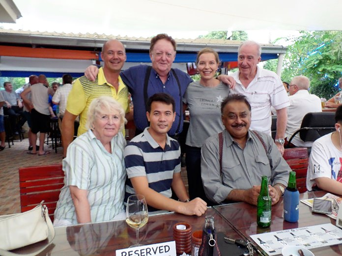 Andre, Allan, Linda and Dr Iain Corness pose for a photo with Foo Smith, Pasit, and Peter Malhotra.