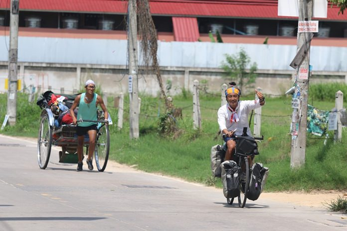 On May 22 they pulled their rickshaw into Pattaya on their way through Thailand.