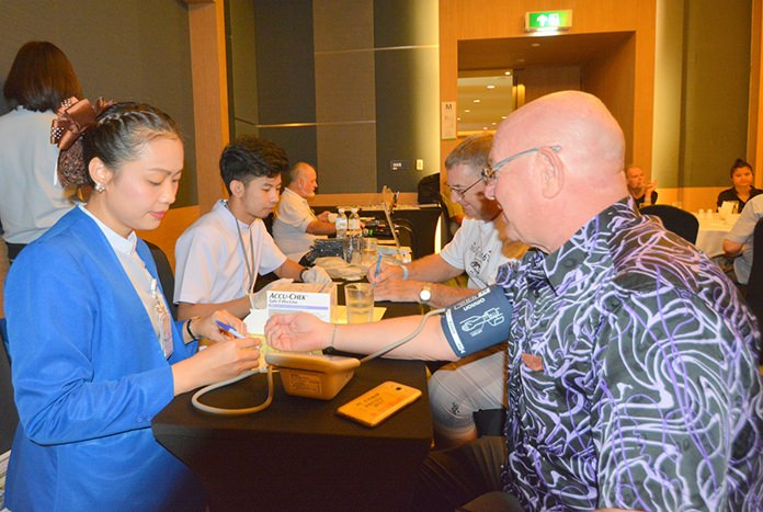 PCEC members and guests take the opportunity to receive free blood pressure and blood sugar checks from Bangkok Hospital Pattaya staff.