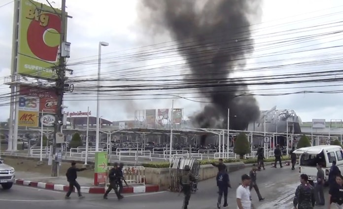 In this image made from video, smoke rises from an exploded vehicle outside a popular shopping center in Pattani province, southern Thailand, Tuesday, May 9, 2017. (AP Photo)