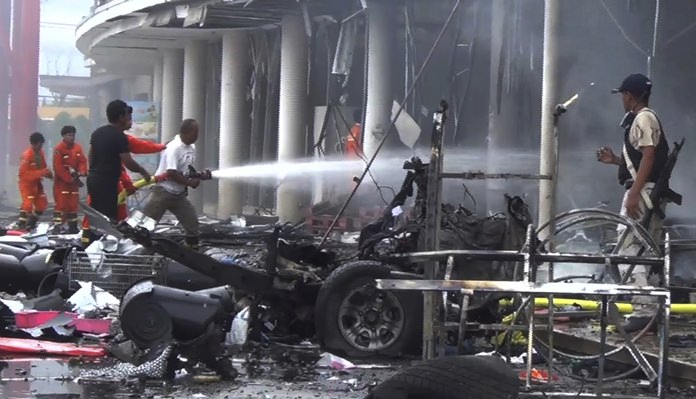 Suspected insurgents detonated a car bomb Tuesday outside the busy shopping center wounding more than 50 people in a huge blast that ripped the building apart and sent people running for their lives. (AP Photo)