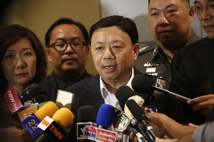 Thailand's National Broadcasting and Telecommunication Commission Secretary-General Takorn Tantasith talks to reporters in Bangkok, Tuesday, May 16. (AP Photo/Sakchai Lalit)