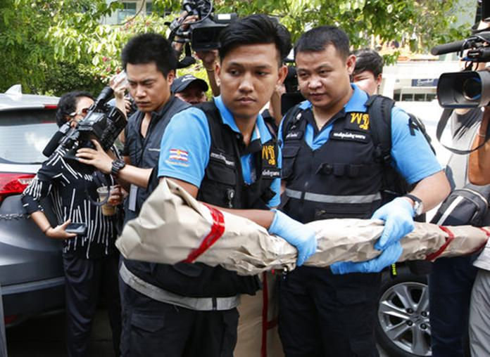 Thai forensic officers carry out collected evidence from Phramongkutklao Hospital. (AP Photo/Sakchai Lalit)