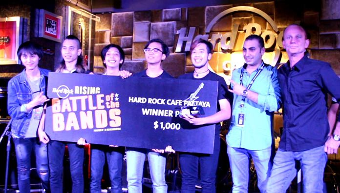 Members of Bangkok based rock band, Sickboy, pose with Hard Rock Pattaya officials on stage during the hotel's international battle of the bands competition, May 20.