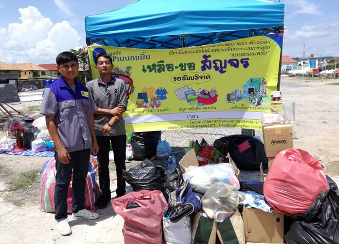 Members of the Baan Nokamin Foundation children's shelter collect cash, clothes and other necessities at a donation event in Pattaya.