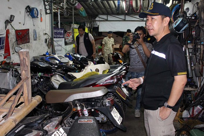 District Chief Naris Niramaiwong led Banglamung District authorities on a raid of a Pattaya-area motorcycle garage that specialized in illegal racing modifications.