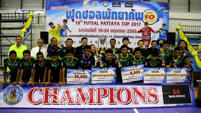 Players from Sukhumnawapan Uppatham School pose with the champions' trophy after winning the under-18 title at the 10th annual Pattaya Futsal Cup.