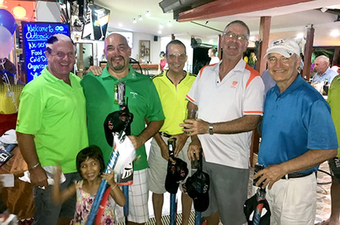 Steve hands out prizes to the winning 4-ball team of Bob St. Aubin, Dennis Persson, Simon Wilcock and Mike Elhert.