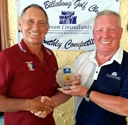 Brian Chapman (right) presents the medal to Bill Marsden.