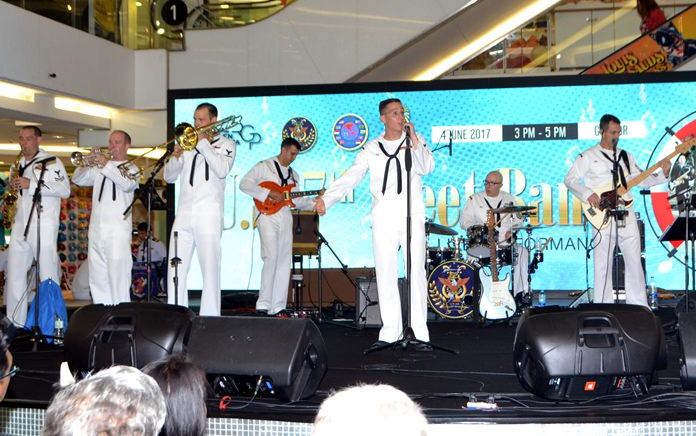 The US Navy's 7th Fleet Band rocks the crowd at Royal Garden Plaza.
