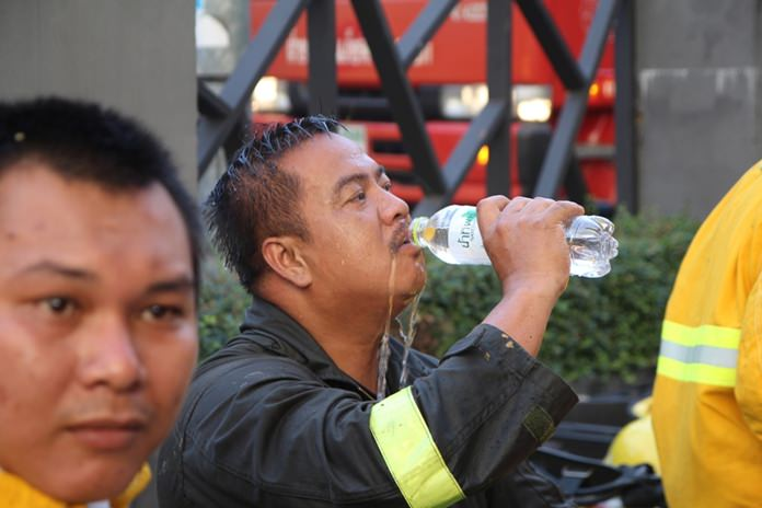 A firefighter takes a much needed drink of water after fighting the flames.