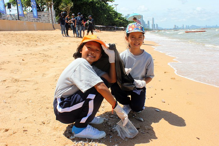 A pair of sunscreen wearers do their part to help the environment.