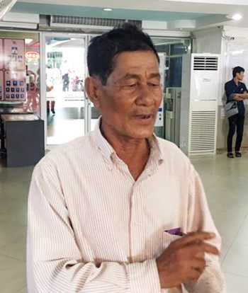 Thongin Panprasong, 71, after he was victimized by con men who prey on senior citizens.