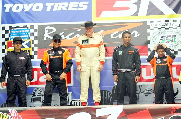 Dr. Iain Corness (centre) stands on the podium after winning first in class at the Bira racetrack in Pattaya, Sunday, June 11.