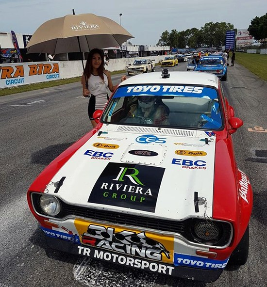 The 1973 Mk1 Ford Escort stands on the grid with Dr. Iain behind the wheel.