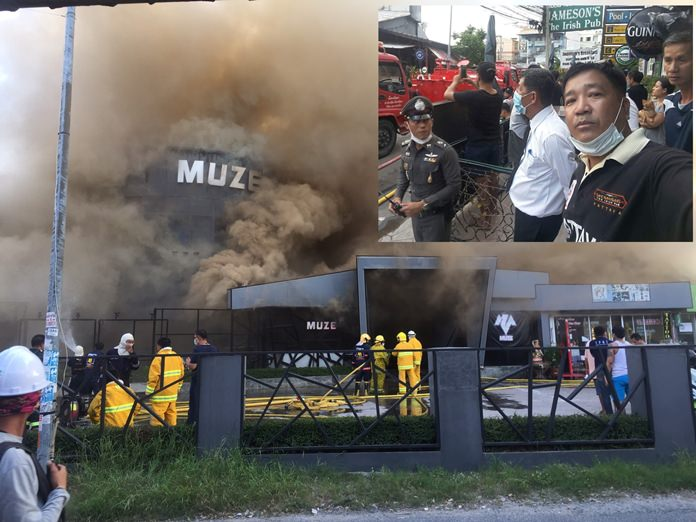 """Five people suffered smoke inhalation – but were saved from more-serious injury by a fast-thinking bystander – when flames raged through the Muze pub on Phettrakul Road around 5 p.m. June 12. An employee of nearby Jameson's restaurant ran into the burning building with a hammer and broke up a jammed service door to free several trapped workers. """"I could see the smoke billowing from the building and I could hear screams above the roar of the flames,"""" said Wanchai Pingate (inset). """"I knew something had to be done."""""""