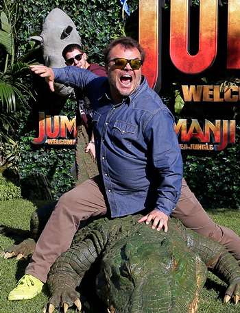 """Actors Jack Black and Nick Jonas pose during a photocall to promote the film """"Jumanji: Welcome to the jungle"""" in Barcelona, Spain, Sunday, June 18. (AP Photo/Manu Fernandez)"""