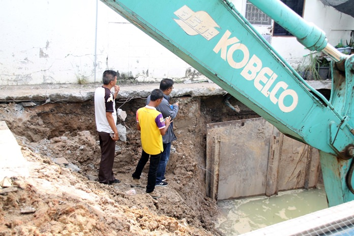 Prasert Laopradit said a drainage pipe-installation project is causing his and other homes to crack and sink.