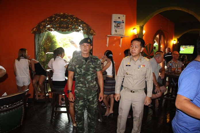 Banglamung District Chief Naris Niramaiwong led the raid of the Rioja Gentlemen's Club on Soi Wat Boonkanchanaram 2.