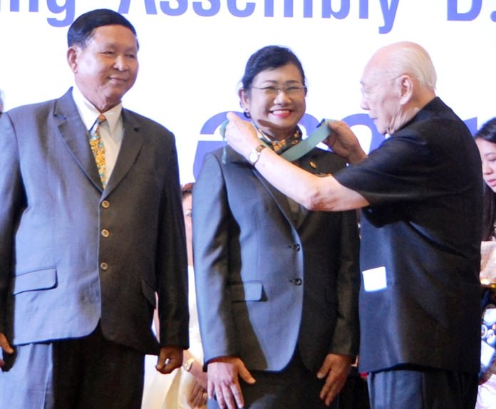 Past Rotary International President Bhichai Rattakul installs Onanong Siripornmanut as Governor of Rotary District 3340 as her caring husband Pradit looks on with pride.