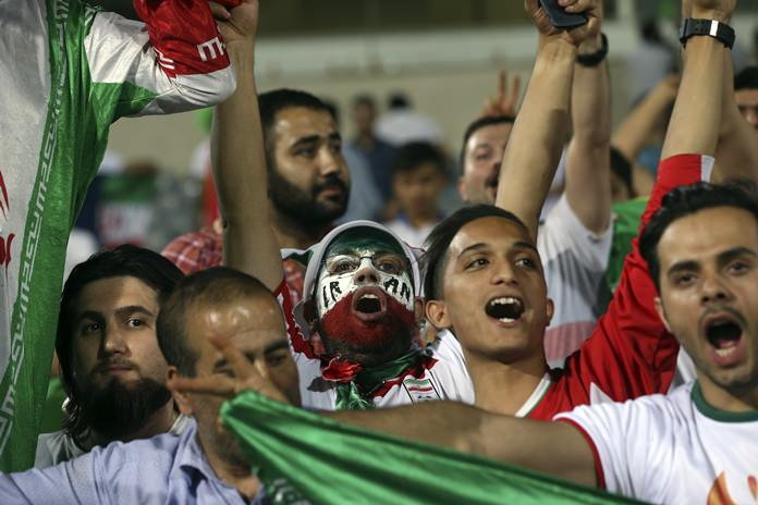 Iranian fans celebrate after their national soccer team defeated Uzbekistan in their Asia Group A 2018 World Cup qualifying match at the Azadi Stadium in Tehran, Iran, Monday, June 12. (AP Photo/Vahid Salemi)