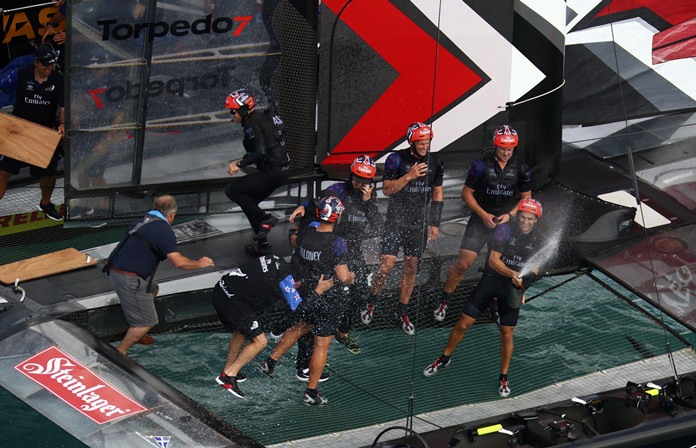 Crew members on Emirates Team New Zealand celebrate after defeating Sweden's Artemis Racing in the America's Cup challenger finals on Bermuda's Great Sound, Monday, June 12. (Gilles Martin-Raget/America's Cup Event Authority via AP)