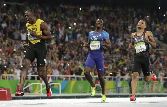 In this Thursday, Aug. 18, 2016 file photo, Usain Bolt from Jamaica, left, crosses the line to win the gold medal in the men's 200-meter final ahead of second placed Canada's Andre De Grasse, right, during the athletics competitions of the 2016 Summer Olympics in Rio de Janeiro, Brazil. (AP Photo/David J. Phillip)