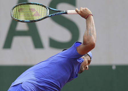 Australia's Nick Kyrgios breaks his racket in his second round match against South Africa's Kevin Anderson at the French Open tennis tournament at the Roland Garros stadium, in Paris, France. Thursday, June 1. (AP Photo/David Vincent)