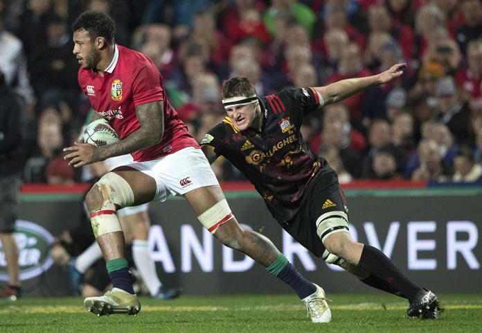 British & Irish Lions second rower Courtney Lawes, left, makes a run during the game against the Chiefs at Waikato Stadium in Hamilton, New Zealand, Tuesday, June 20. (Brett Phibbs/New Zealand Herald via AP)