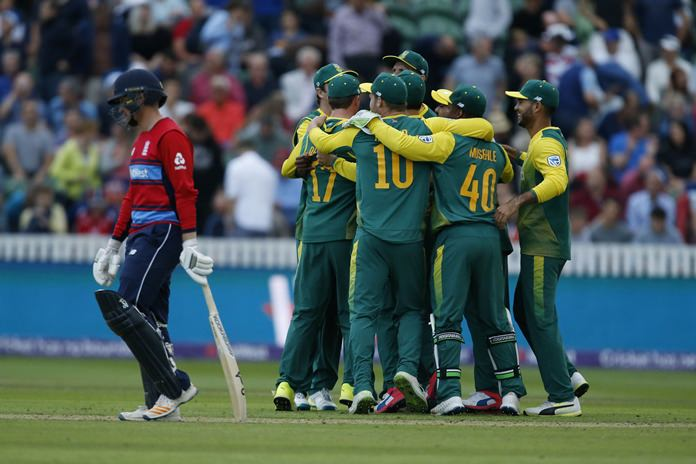 South Africa teammates celebrate at the end of the second T20 Blast match against England at the Cooper Associates County Ground in Taunton, England, Friday June 23. (Paul Harding/PA via AP)