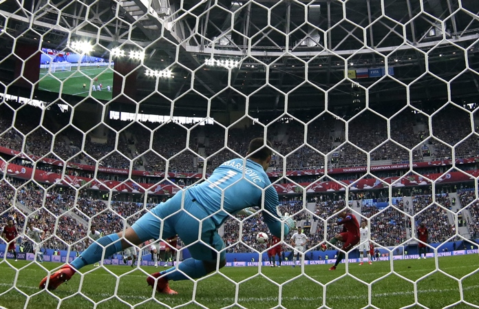 Portugal's Cristiano Ronaldo, right, scores his side's first goal during the Confederations Cup, Group A soccer match against New Zealand at the St. Petersburg Stadium, Russia, Saturday June 24. (AP Photo/Pavel Golovkin)