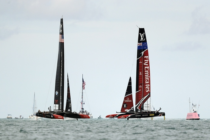 Emirates Team New Zealand, right, races Oracle Team USA during the sixth race of the America's Cup sailing competition Saturday, June 24, in Hamilton, Bermuda. (AP Photo/Gregory Bull)