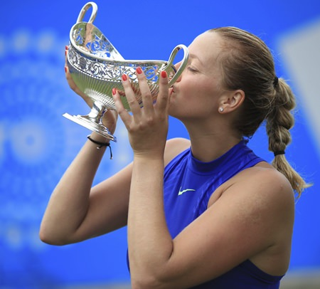 Czech Republic's Petra Kvitova celebrates with the trophy after winning the final at the Aegon Classic tennis tournament in Birmingham, England, Sunday June 25. (Mike Egerton/PA via AP)