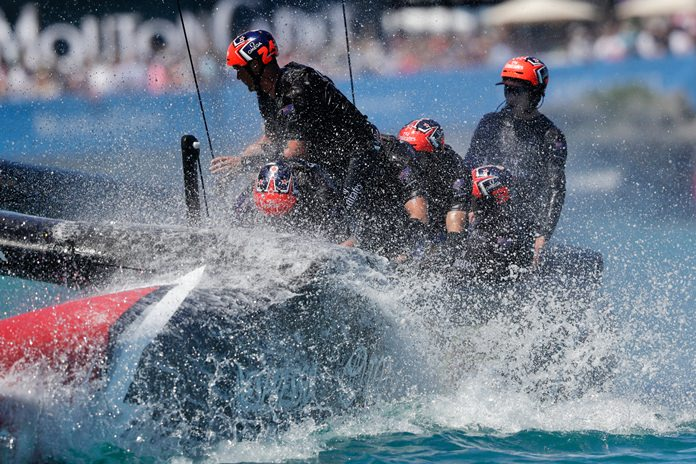 Emirates Team New Zealand helmsman Peter Burling, right, steers as they cross the finish line to defeat Oracle Team USA during the eighth race of America's Cup sailing competition Sunday, June 25, in Hamilton, Bermuda. (AP Photo/Gregory Bull)