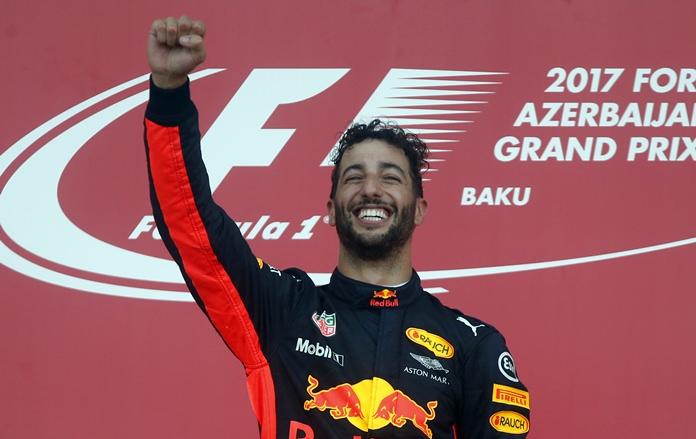 Red Bull driver Daniel Ricciardo of Australia celebrates on the podium after winning the Formula One Azerbaijan Grand Prix in Baku, Azerbaijan, Sunday, June 25. (AP Photo/Darko Bandic)