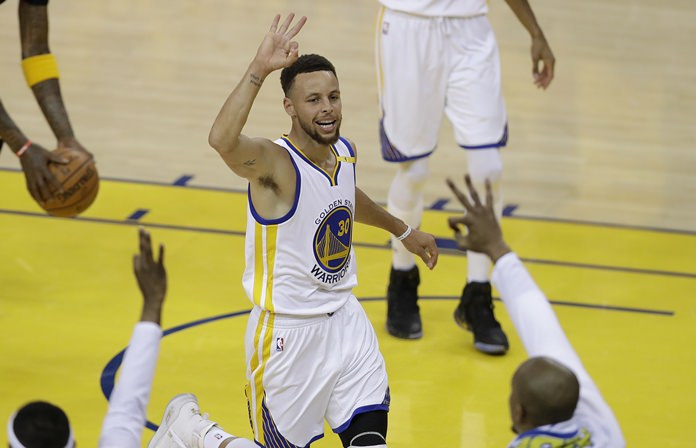 Golden State Warriors guard Stephen Curry (30) gestures after scoring against the Cleveland Cavaliers during the first half of Game 2 of basketball's NBA Finals in Oakland, Calif., Sunday, June 4. (AP Photo/Marcio Jose Sanchez)
