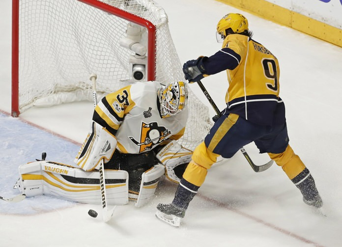 Pittsburgh Penguins goalie Matt Murray (30) stops a shot by Nashville Predators left wing Filip Forsberg (9), of Sweden, during the third period in Game 4 of the NHL hockey Stanley Cup Finals Monday, June 5, in Nashville, Tenn. (AP Photo/Mark Humphrey)