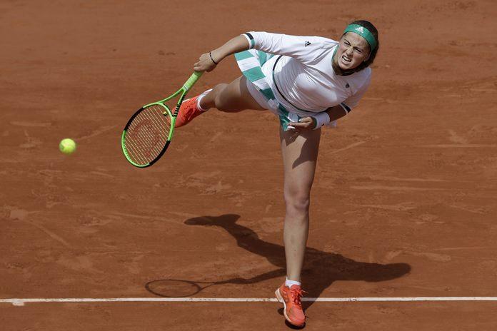 Latvia's Jelena Ostapenko serves against Denmark's Caroline Wozniacki during their quarterfinal match of the French Open tennis tournament at the Roland Garros stadium, in Paris, France. Tuesday, June 6. (AP Photo/Petr David Josek)