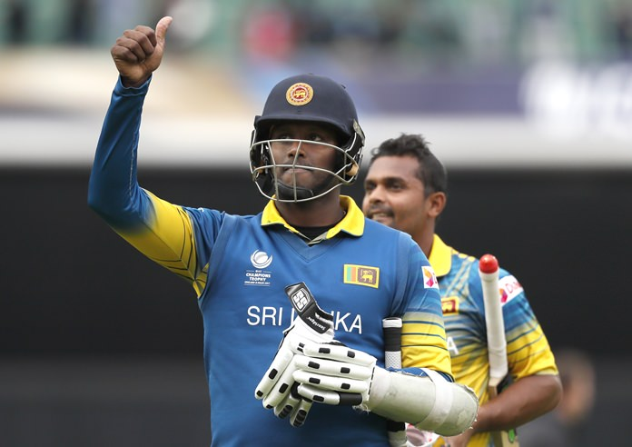 Sri Lanka's captain Angelo Mathews gives the thumbs up sign as he leaves the pitch after the ICC Champions Trophy victory over India at The Oval cricket ground in London, Thursday, June 8. (AP Photo/Kirsty Wigglesworth)