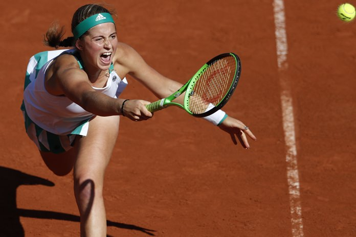 Latvia's Jelena Ostapenko plays a shot against Timea Bacsinszky of Switzerland during their semifinal match of the French Open tennis tournament at the Roland Garros stadium, in Paris, France. Thursday, June 8. (AP Photo/Petr David Josek)